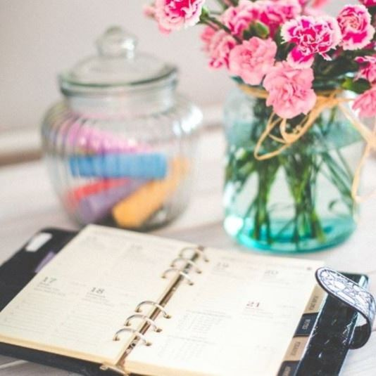 Desk with Agenda and Flowers